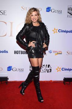 Fanny Lu attends Silence film premiere. Leather jacket open toe OTK boots