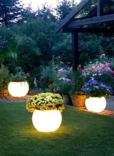 Get a flower pot and Rustoleum's Glow In The Dark Paint and paint it on the pot. During the day the paint will absorb the sunlight making it glow at night! You can do this with rocks also to make pathways.