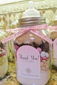 Cute cookie mix in a mason jar to look like a baby bottle! Perfect favor for a girl baby shower! See more party ideas at CatchMyParty.com.