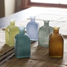 """West Elm: Diminutive vessels in jewel tones host buds in a spectrum of sophisticated hues—making a bold impact when displayed en masse in multiple colors.     • Recycled glass.  • 2.4""""sq. x 5.3""""h.  • Hand wash.  • Imported."""