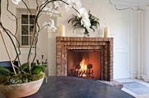Brick framed fireplace surrounded by custom white millwork  Architectural Details  TraditionalNeoclassical  Patio by Wade Weissmann Architecture Inc