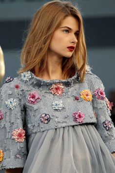 Chanel haute couture...why do models always have a look of disdain on their faces?