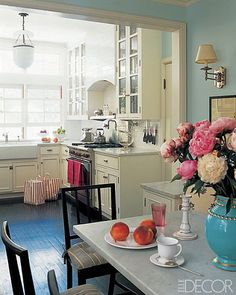 that dining room wall color was meant for that vase the flowers are in ♥ what a perfectly pretty space...call it vintage ~ happy