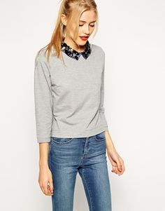 Sweatshirt by ASOS Collection Soft touch, thick jersey Jewel embellished collar Zip back fastening Regular fit - true to size Hand wash 64% Polyester, 36% Cotton Our model wears a UK 8/EU 36/US 4 A...