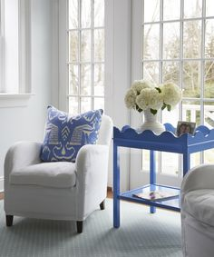 This blue painted table from Oomph is a perfect partner to the classic white armchair