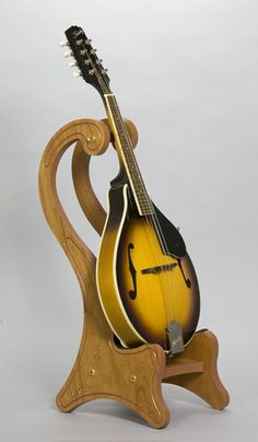 Mandolin stand -- hmmm...need to show this to my Dad for all his free time woodworking activities ;) ha
