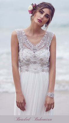 Inspired by the fabulously popular Anna Campbell Madison style Boho Beaded beach wedding gown. Each dress is hand cut and beaded with Swarovski crystals and other beading of the highest quality. This