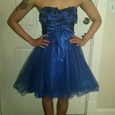 Masquerade prom dress This is knee length sapphire blue homecoming/prom dress from.. Masquerade size  3/4 (small) Dress i bought from another follow posher it was for my daughter but dress doesnt fit her...  dress is in perfect condition... Masquerade  Dresses