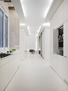 Crusch alba (white cross) flat interior by Gus Wüstemann in Barcelona, Spain - great use of recessed strip lights to highlight architectural form Cove Lighting, Indirect Lighting, Lighting Design, Corridor Lighting, Hidden Lighting, Apartment Interior Design, Kitchen Interior, Kitchen Design, Interior Architecture