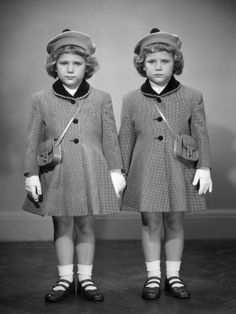 Twin Girls in Hats and Coats Wearing White Gloves