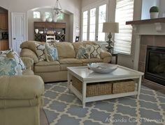 Like this coffee table look with the baskets for storage. Amanda Carol at Home: Client Project