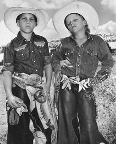 Craig Scarmardo, age 10, and Cheyloh Mather, age 11, practice their hardened-cowboy looks at the Boerne rodeo. By Mary Ellen Mark
