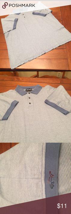 Men's Greg Norman Polo Two tone light blue polo shirt. Greg Norman shark logo on sleeve. Greg Norman Shirts Polos