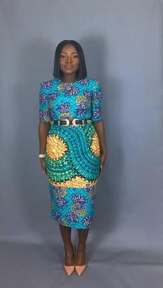 Two African wax print combined into one lovely bodycon dress with pockets African Attire, African Wear, African Women, African Print Dresses, African Fashion Dresses, African Prints, African Outfits, Ankara Gowns, Ankara Dress