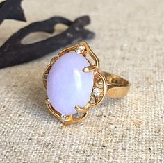 A personal favorite from my Etsy shop https://www.etsy.com/listing/221744449/sale-vintage-ring-oval-purple-cabochon