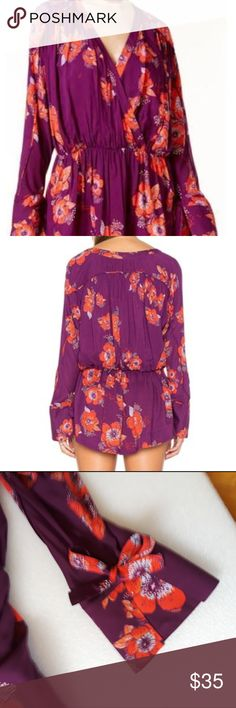 **$$ALE** Free People Tuscan Dreams mini dress -Sm Floral plum mini-dress/top/tunic with long bell sleeve cuff with tie accent Pull over, elastic waist 100 % viscose nylon  length approx. front 26 inch back 29 inch Free People Dresses Mini