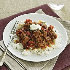 Indian Lamb Curry - A combo of tomato juice and flour creates a thick sauce. Serve with a piece of naan to sop up any extra. Lamb Recipes, Curry Recipes, Slow Cooker Recipes, Meat Recipes, Indian Food Recipes, Crockpot Recipes, Cooking Recipes, Healthy Recipes, Slow Cooking