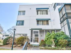 1367 Chalmette Dr NE - Art-Deco, Mid-Century styled, corner, end-unit. Rarely available, Iconic building, Light & Spacious 1 bd 1 ba w/ classic features. 2 private entrys, 2 screened patios. Sunshine floods space with a good vibes. Update kitchen with granite counters, appls. Rare, easy Washer & Dryer access, plus 8' x 6' Storage Unit. Low HOA, solid history. New wide-plank hardwood floors thruout. Updated lighting.