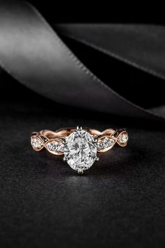 Timeless and refined, this beautiful vintage diamond engagement ring sparkles with bezel-set diamonds set in blushing 14k rose gold. A 1.25-carat oval diamond center stone is hand-picked for exceptional sparkle.