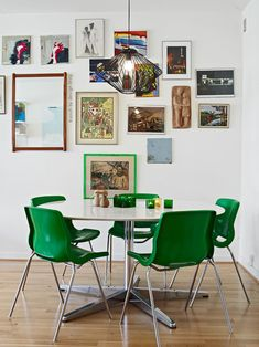 arrangement of art and table shape. kelly green dining chairs in the dining room. home decor and interior decorating ideas. Room Inspiration, Interior Inspiration, Table And Chairs, Dining Chairs, Ikea Chairs, Wooden Chairs, Kitchen Chairs, Wood Table, Kitchen Dining