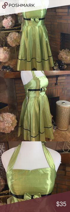 Belle Pogue chartreuse party dress sz XL Belle Pogue chartreuse party dress sz XL. New with tags. Corset back and halter strap tie. There is some give because of the Corset. The basic measurements are a 38inch bust, 34in waist and 34in long. It has a retro look. Please check out all pictures for best description of the items. Ask me any questions and happy shopping. Belle Pogue  Dresses Strapless