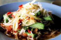 Som Tam (Thailand). 'Som tam is made by slicing or shredding crispy unripe papaya into long strands that are then bruised in a mortar and pestle with fish sauce, lime juice, sugar, MSG, chilli, garlic and often slices of tomato and long bean. The result is a refreshing and often ballistically spicy salad that functions equally well as part of a meal or as a stand-alone snack.' http://www.lonelyplanet.com/thailand