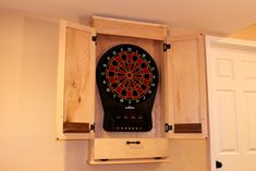 Build a Simple Dartboard Cabinet Furniture Projects, Wood Furniture, Wood Projects, Electronic Dart Board Cabinet, Dartboard Cabinet Plans, Dart Board Backboard, Woodworking Plans, Woodworking Projects, Game Room Basement