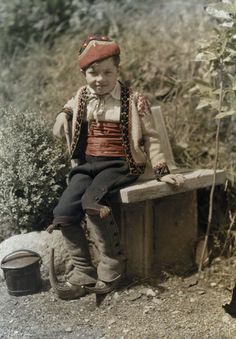 Bethmale small boy in traditional clothing including the shoes 'sabots' - Ariège dept. - Midi-Pyrénées région, France