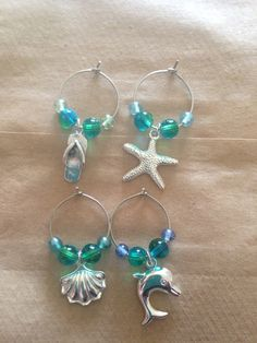 Favors!  I would live to add names to personalize them.  Tropical wine glass charms on Etsy, $8.00