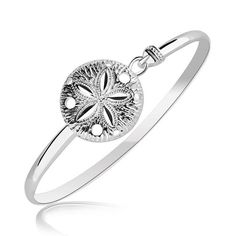 Calling to mind beach holidays, this slim bangle showcases an intricately crafted sand dollar. Designed in rhodium plated sterling silver and available in sizes 7'' and 8''.