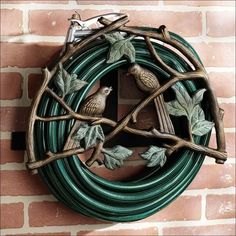 Ideas, Amazing Garden Hose Holder Made From Wrought Iron Materials And Have Decorative Designs With Birds Ornaments 004: Garden Hose Storage...