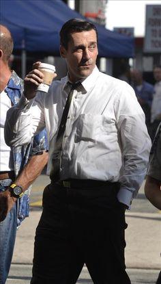 John Hamm drinks coffee on the set of Mad Men