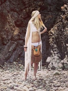 For the wanderlust voyager with freedom in your heart and adventure in your soul. Stunning luxury hand-crafted handbag in thick soft nubuck buffalo leather with draping tassels and raw leather edges finished with a hand sewn thick stitch design. The bag features a handcrafted turquoise cabochon pendant embellishment, which is signature to Sabaii and has 100% pig suede inner lining. Front open pocket, inside slip pocket & a back zipper pocket. Finished with the embossed Sabaii logo.