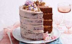 Decorated with an easy 'naked' butter cream frosting, vienna almonds and a sprinkle of edible flowers, this four-layer caramel mud cake will make an eye-catching centrepiece at any event. White Chocolate Mud Cake, Decadent Chocolate, Caramel Mud Cake, Rich Cake, Layer Cake Recipes, Layer Cakes, Big Cakes, Dessert For Dinner, Dessert Ideas