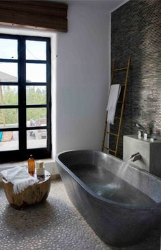Love the pebble floor & tile wall
