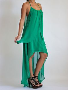 Emerald Flowy Halter Fishtail Dress $55 Beautiful green flowy halter dress with fishtail back and double draping perfect for your late night dinner date.