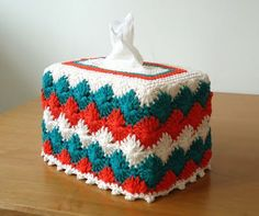 I actually think tissue box covers are way glam.   Free pattern, via Stitch of Love.