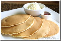FLUFFY PANCAKES - I have tried many pancake recipes and this particular one has a permanent page in Cusinera's private cookbook.  Tried and tested. -INGREDIENTS:- 2 1/2c  plain flour 2 eggs 1/2c white sugar 2 heaping tsp baking powder 2t baking soda 1/2 cup cooking oil 1/4t salt 2 1/2 cups = (2T + 1 1/2t lemon juice and rest milk) ==