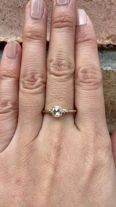 One of a kind ring Stock size: US 7 Re-sizable size: Size 4-8.5 Round Rose Cut Diamond 0.40ct., 5.5mm, G color VS quality diamond Accented diamond weight ≈0.06ctw Band Width: ≈1.4mm Band Height: ≈1.7mm Setting Style: Elevated for easy stacking Solid 14k gold