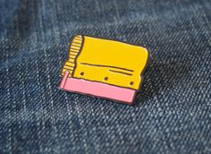 Squeegee enamel pin.  Every screen printer or screen print lover needs one.  Red , brown , black Approx 1 1/4 wide