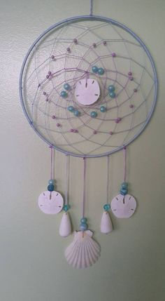 Violet and seashells. Dreamcatchers, Seashells, Yellow, Artwork, Crafts, Crafts To Make, Octopus, Conch Shells, Work Of Art