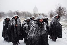 A group of nuns visiting Washington, D.C. from their convent in Chicago walk in the early snow from a major blizzard outside the U.S. Capitol in Washington, DC, USA on Jan. 22, 2016. A major blizzard, Winter Storm Jonas, is expected to dump over two feet (61 centimeters) of snow in the mid-Atlantic region this coming weekend.