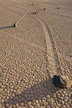 """Located in one of the flattest places on the face of this planet are the strange and unexplained Sailing Stones of Racetrack Playa, Death Valley, California. Once a year the """"Playa"""" or flat desert pan experiences short winter rains and becomes slippery as the hexagonal desert floor turns back to mud. During this time the boulders and rocks move leaving clearly visible tracks behind them. death valley race track, nation park, earth homes, sail stone, sailing stones, national parks, move rock, desert floor, death valley california"""