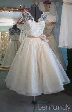 short V neck princess lace and tulle wedding dress with cap sleeves. $178.00, via Etsy.