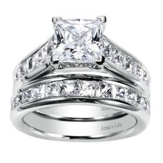 This princess cut diamond engagement ring comes with a matching band to cushion it.