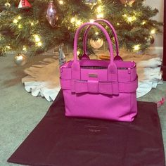 "Kate Spade Quinn bow front bag This super cute purse comes a beautiful shade of pink called ""stuningpnk"". Retails for $398. Carried lightly and only shows wear on the bottom corners as pictured. Overall great condition! Comes with dustbag & original tags. kate spade Bags"