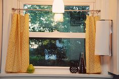 Easy Window Treatment. Cute dishtowels, tension rod, and curtain clips. I will be making mine at once!