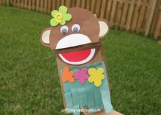 There aren't a ton of luau crafts out there so I though I'd share this cute Hula Monkey Puppet that my friend came up with for the kids to make!
