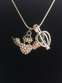 A personal favorite from my Etsy shop https://www.etsy.com/listing/525330573/angel-wing-charm-necklace-oysters-with