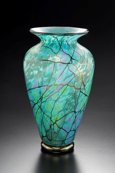 Click on the images above for a larger view. A self-taught glass artist and born and raised in Vallejo, California, David Lindsay graduated from St. Patrick High School in 1975. A few months later, he became an apprentice at Nourot Glass Studio in 1976. Over the following six years, David advanced from apprentice to assistant glass blower to gaffer. David became proficient in all aspects of the glass production process from mixing batch to monitoring the melting process to blowing pieces to…